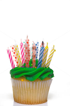 Birthday Cupcake stock photo, A cupcake covered in colorful birthday candles. by Robert Byron