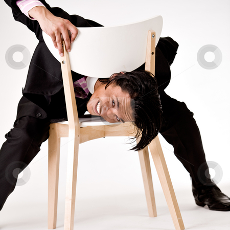 Young man is acting like an idiot stock photo, Young indonesian man in a business suit by Frenk and Danielle Kaufmann