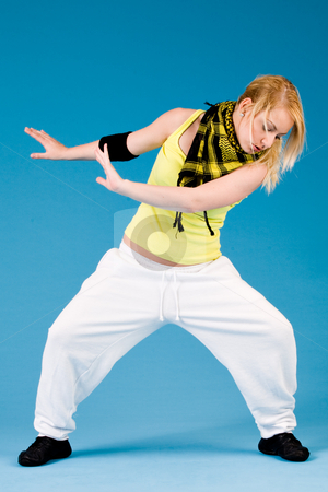 Girl is Streetdancing stock photo, Attractive blond girl is dancing on a blue background by Frenk and Danielle Kaufmann