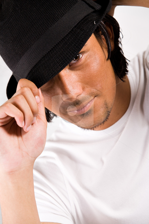 Sexy boy with a hat stock photo, Indonesian young man with a sexy look by Frenk and Danielle Kaufmann