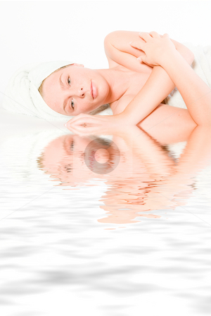 Wellness girl series laying down resting stock photo, Studio portrait of a spa girl resting by Frenk and Danielle Kaufmann