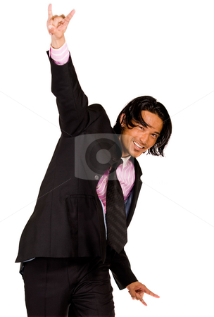 The winning business man stock photo, Young indonesian man in a business suit by Frenk and Danielle Kaufmann