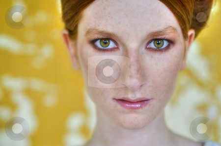Red head, green eyes and yellow wall stock photo, Portrait of a natural redhead in front of a yellow wall by Frenk and Danielle Kaufmann
