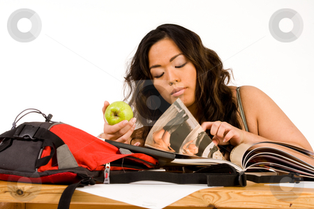 Student is learning stock photo, Sexy school girl learning for her exam by Frenk and Danielle Kaufmann