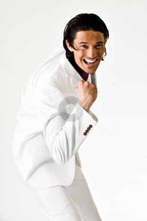 Sexy boy is happy stock photo, Young indonesian man in a business suit by Frenk and Danielle Kaufmann
