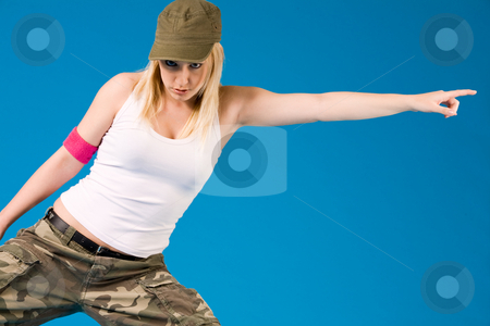 Blond sexy girl witha dance move stock photo, Attractive blond girl is dancing on a blue background by Frenk and Danielle Kaufmann