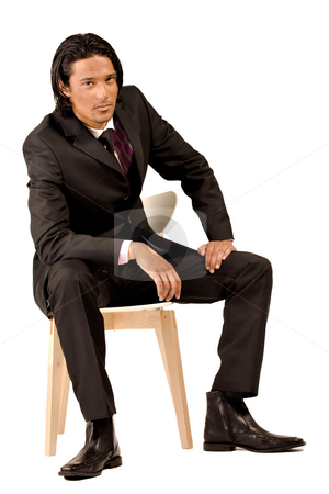 Young business man stock photo, Young indonesian man in a business suit by Frenk and Danielle Kaufmann