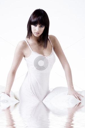 Woman in nightgown in water stock photo, Cute brunette flirting in bed dressed in a white nightgown by Frenk and Danielle Kaufmann