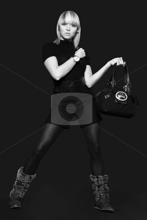 Model with a bag stock photo, A model portrait in the studio by Frenk and Danielle Kaufmann