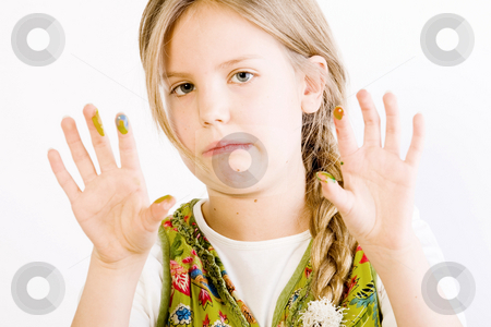 Young girl with paint on hands stock photo, Studio portrait of a young blond girl showing her hands smudged with paint by Frenk and Danielle Kaufmann