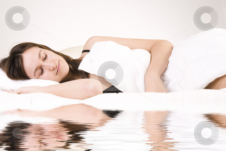 Sleeping woman stock photo, Young adult woman in the studio on a bed by Frenk and Danielle Kaufmann