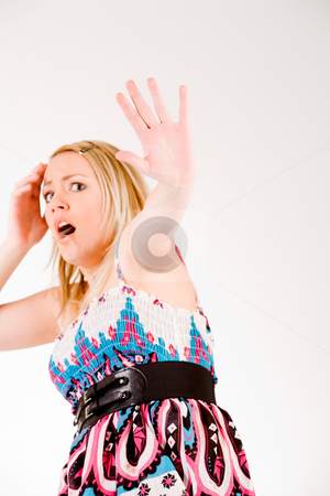 Panicked woman holding up hand stock photo, Young sexy blond girl is giving signs by Frenk and Danielle Kaufmann