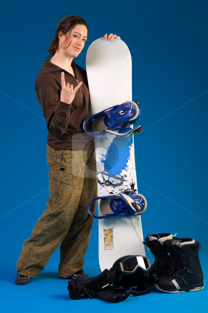Woman with long curly hair giving a hang loose stock photo, Portrait of a woman with long curly hair with snowboard making the hang loose sign by Frenk and Danielle Kaufmann