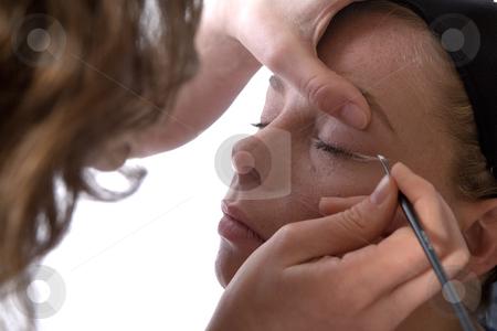 Making up an eye stock photo, Studio image of make-up artist at work by Frenk and Danielle Kaufmann