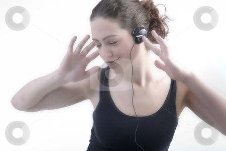 Woman with long curly hair enjoying the music stock photo, Portrait of a woman with long curly hair listening to music on her head[hone by Frenk and Danielle Kaufmann