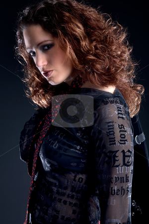 Woman with long curly hair looking confident stock photo, Portrait of a woman with long curly hair looking confident at you by Frenk and Danielle Kaufmann