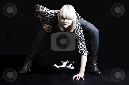 Fashion with a cat 2 stock photo, A model portrait in the studio by Frenk and Danielle Kaufmann