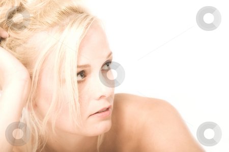 Beautiful blond in thoughts stock photo, Portrait of a beautiful blond in the studio in thoughts by Frenk and Danielle Kaufmann
