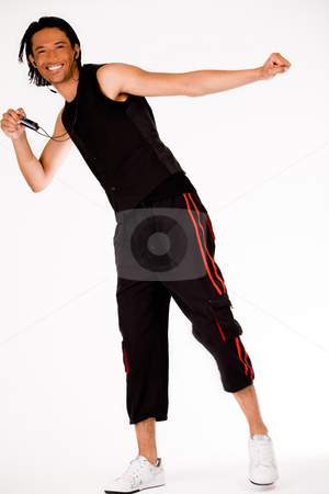 Dancing man stock photo, Dancing indonesian man with his mp3 player by Frenk and Danielle Kaufmann