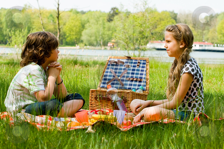 Picnic and waiting stock photo, Two children enjoying a picnic in the summer by Frenk and Danielle Kaufmann