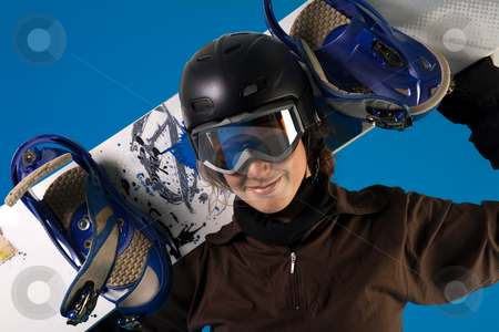 Woman with long curly hair with snowboard in her neck stock photo, Portrait of a woman with long curly hair by Frenk and Danielle Kaufmann