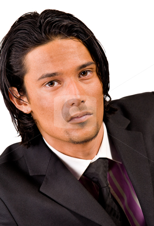 Portrait in a business suit stock photo, Young indonesian man in a business suit by Frenk and Danielle Kaufmann