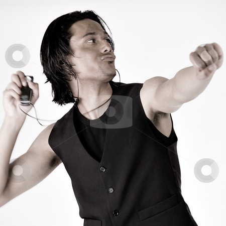 Indonesian man with mp3 player stock photo, Dancing indonesian man with his mp3 player by Frenk and Danielle Kaufmann