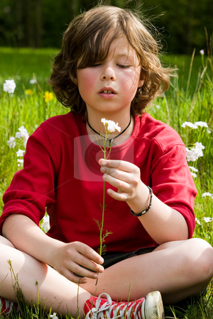 Looking to the flower stock photo, Young boy is looking to his flower by Frenk and Danielle Kaufmann