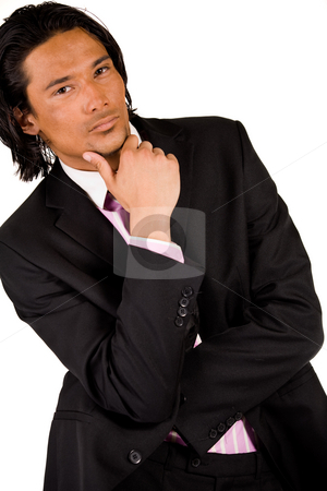 Businessman is thinking stock photo, Young indonesian man in a business suit by Frenk and Danielle Kaufmann