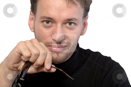 Portrait of a young adult man stock photo, Studio portrait of a young adult man by Frenk and Danielle Kaufmann