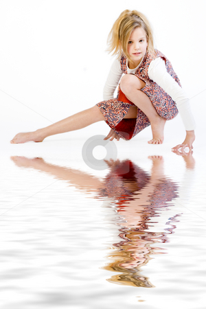 Blond child stretching her leg stock photo, Studio portrait of a blond child stretching by Frenk and Danielle Kaufmann