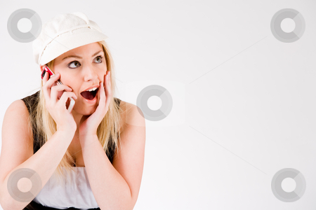 Happy Callgirl stock photo, Young blond girl is busy with her cell phone by Frenk and Danielle Kaufmann
