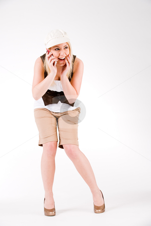 Attractive callgirl stock photo, Young blond girl is busy with her cell phone by Frenk and Danielle Kaufmann