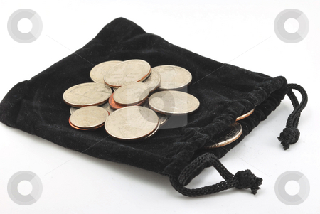 Coins stock photo, Coins on a black velvet pouch by Robert Cabrera