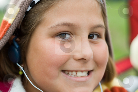 Listening To Music stock photo, Close-up view of a young girl listening to music by Richard Nelson