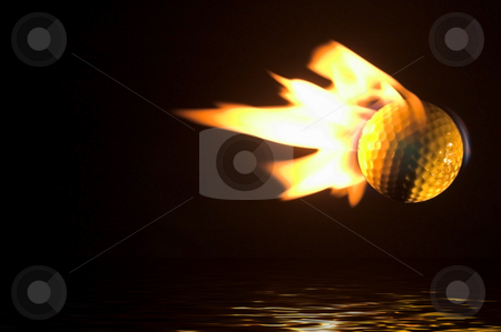 Flaming Golf Ball Over Water stock photo, A flaming golf ball flying over a water hazard. by Robert Byron