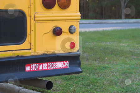 School Bus Safety stock photo, Schhol bus bumper sticker - We stop at railroad crossings. by Robert Byron