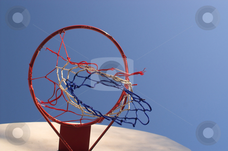 Basketball Goal stock photo, A tattered basketball goal outside on a sunny day. by Robert Byron
