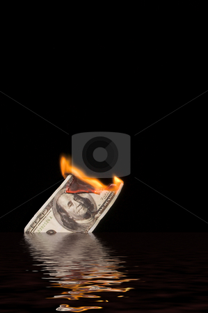 Burning 100 dollar bill in water stock photo, A one hundred dollar bill on fire as it sinks.  100$ bill burning. by Robert Byron
