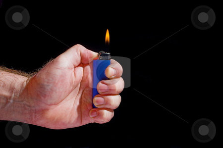 Disposable Lighter stock photo, A person lighting a disposable butane lighter. by Robert Byron