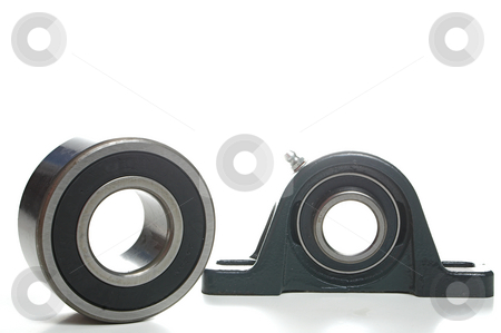 Bearings stock photo, Standard mechanical bearings used in various types of machinery. by Robert Byron