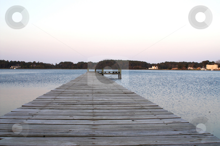 Wood plank dock stock photo, A fishing pier and / or boat dock. by Robert Byron