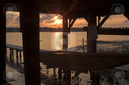 Boat Dock Sunrise or Sunset stock photo, The sunset or sunrise as seen through a boat dock. by Robert Byron