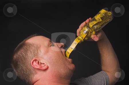 Diet Drink stock photo, A man enjoying a beverage. Diet drink concept. by Robert Byron