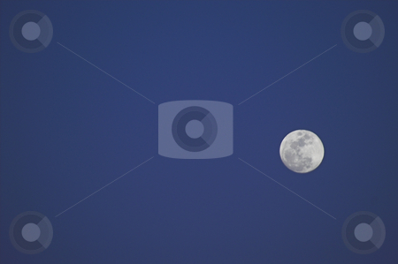 Full Moon stock photo, A full moon against a blue evening sky. by Robert Byron
