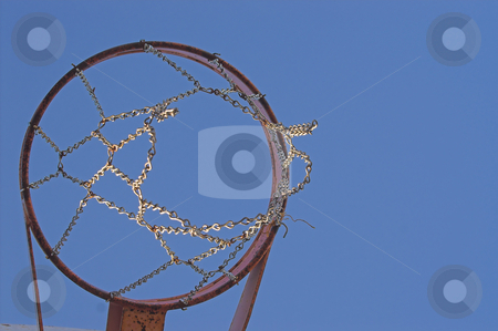 Basketball Goal stock photo, An old chain type basketball goal outside on a sunny day. by Robert Byron