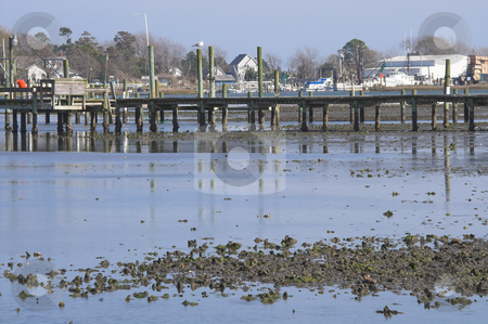 Ocean Pier stock photo, A fishing and boat pier at the ocean. by Robert Byron