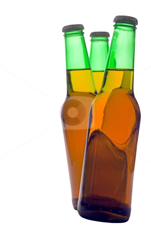 Three full Beer bottles stock photo, Delicious cold beer dancing into as to intice by Robert Byron