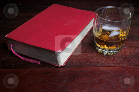 Inspiration stock photo, A glass of bourbon on the rocks next to a bible. by Robert Byron