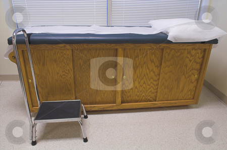 Patient Examination Table stock photo, A patient examination table at a doctor's office. by Robert Byron